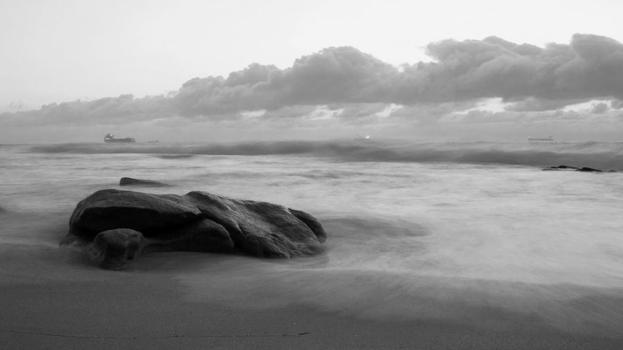 Waves crashing over single rock at sunrise, Durban South Africa Beach Beauty In Nature Day Horizon Over Water Monochrome Monochrome Landscape Nature No People Outdoors Scenics Sea Sky Tranquil Scene Tranquility Water Wave