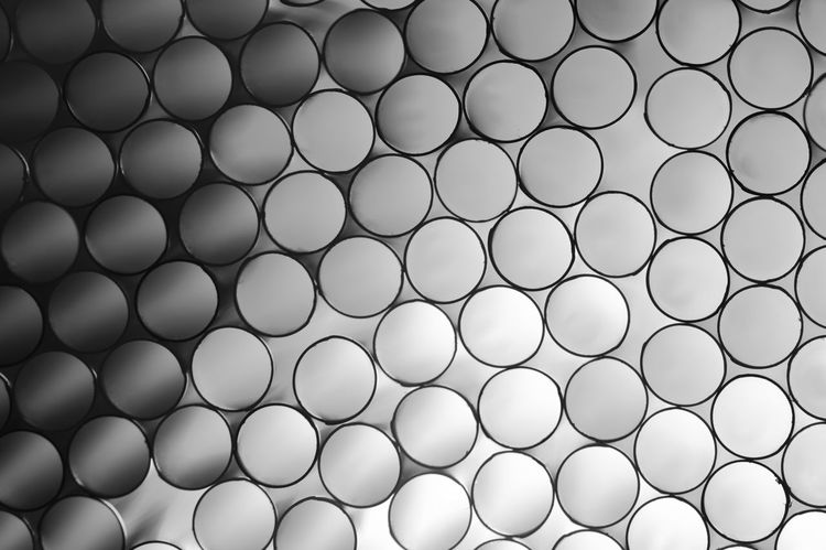 Macro shot of backlit drinking straws Abstract Backgrounds Circles Close-up Detail Drinking Straws Fine Art First Eyeem Photo Geometric Shape Illuminated In A Row Large Group Of Objects Macro Pattern Repetition Round Shape Shapes Shapes And Forms Side By Side Straws Tubes