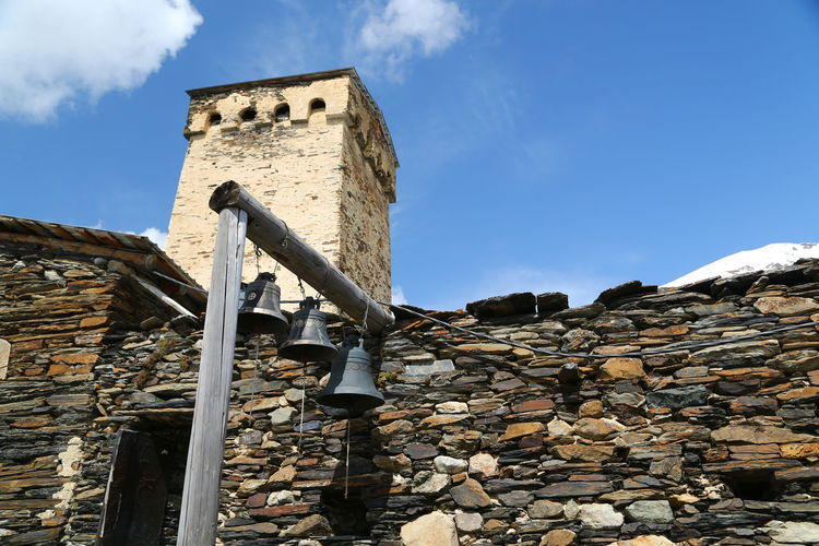 Sky Architecture Low Angle View Built Structure Day Nature Stone Wall Solid Wall Building Exterior History No People Cloud - Sky Stone - Object The Past Outdoors Sunlight Blue Wall - Building Feature Old Georgia Mestia/town In Svaneti/Georgia