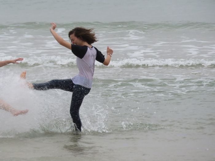 Girl Power Happy Happiness Water Sea Playing Press For Progress Motion Exercising Sea One Person Beach Vitality Dancing People Healthy Lifestyle Full Length Balance Dancer Sand Sport Fun One Woman Only Standing Flexibility Strength Summer Exploratorium