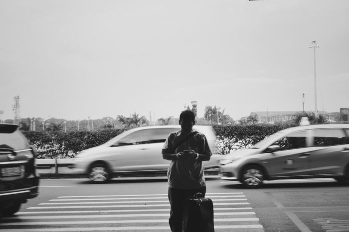 Standing alone Car Rear View Transportation Clear Sky Land Vehicle Mode Of Transport Real People One Person Jakarta Streetphotography Streetphoto_bw Day Outdoors Sky People