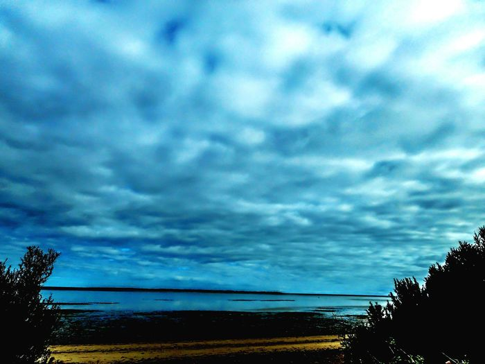 Storm Cloud Beach Cloud - Sky Nature Sand Landscape Sea Sky Thunderstorm Storm Outdoors Dramatic Sky Summer No People Scenics Ominous Outside Photography Coastline Eyeem Market Tranquility Tranquil Scene Beauty In Nature Horizon Over Water Nature Dramatic Sky