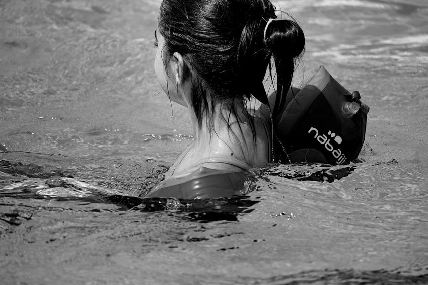 Blackandwhite Black And White Black & White EyeEm Best Shots - Black + White People Waterfront Clear Water Purity Swimming Swimming Pool Pool Wet Wet Hair Girl Learning Sport Motion Activity Fun Side View Child Children Young Girl Human Body Part Close-up One Person Real People Leisure Activity Lifestyles Hairstyle Hair Long Hair Day Women Nature Rear View Selective Focus Outdoors Human Hair Water Beach