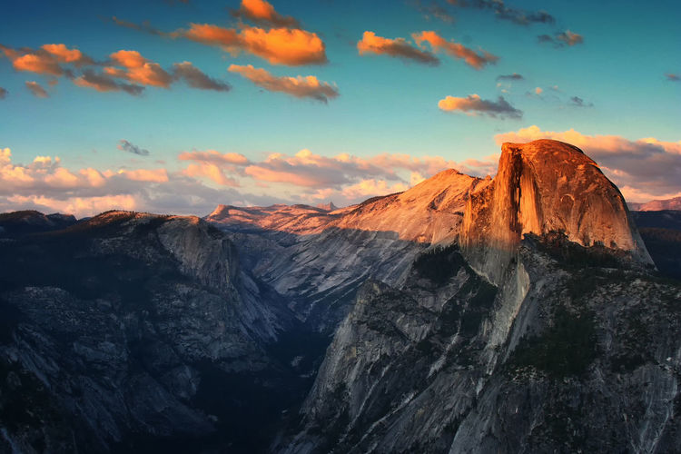 Half Dome rock formation during sunset with twilight sky in Yosemite National Park. Beautiful scenic view from Glacier Point in summer... Half Dome Landscape_Collection Nature Sunset_collection Travel Twilight USA Yosemite National Park America Beauty In Nature Day Dusk Landscape Mountain Mountain Range Nature No People Outdoors Road Trip Scenics Sky Sunset