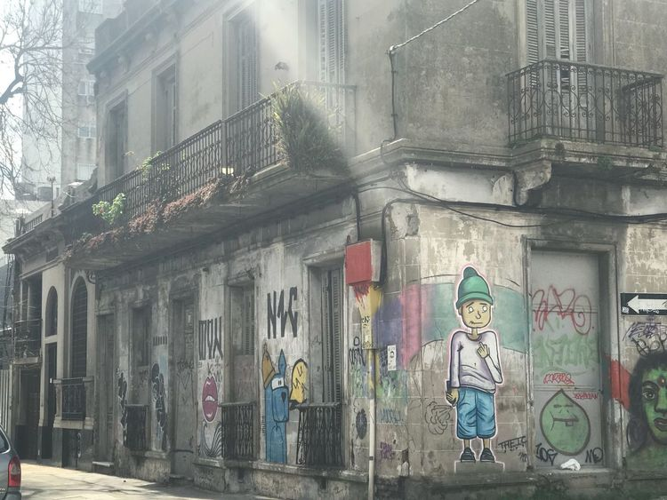 Street art Building Exterior Built Structure Architecture Art And Craft Building Representation Human Representation Graffiti Creativity Day No People City Window Wall - Building Feature Outdoors Male Likeness Female Likeness Street Text Store