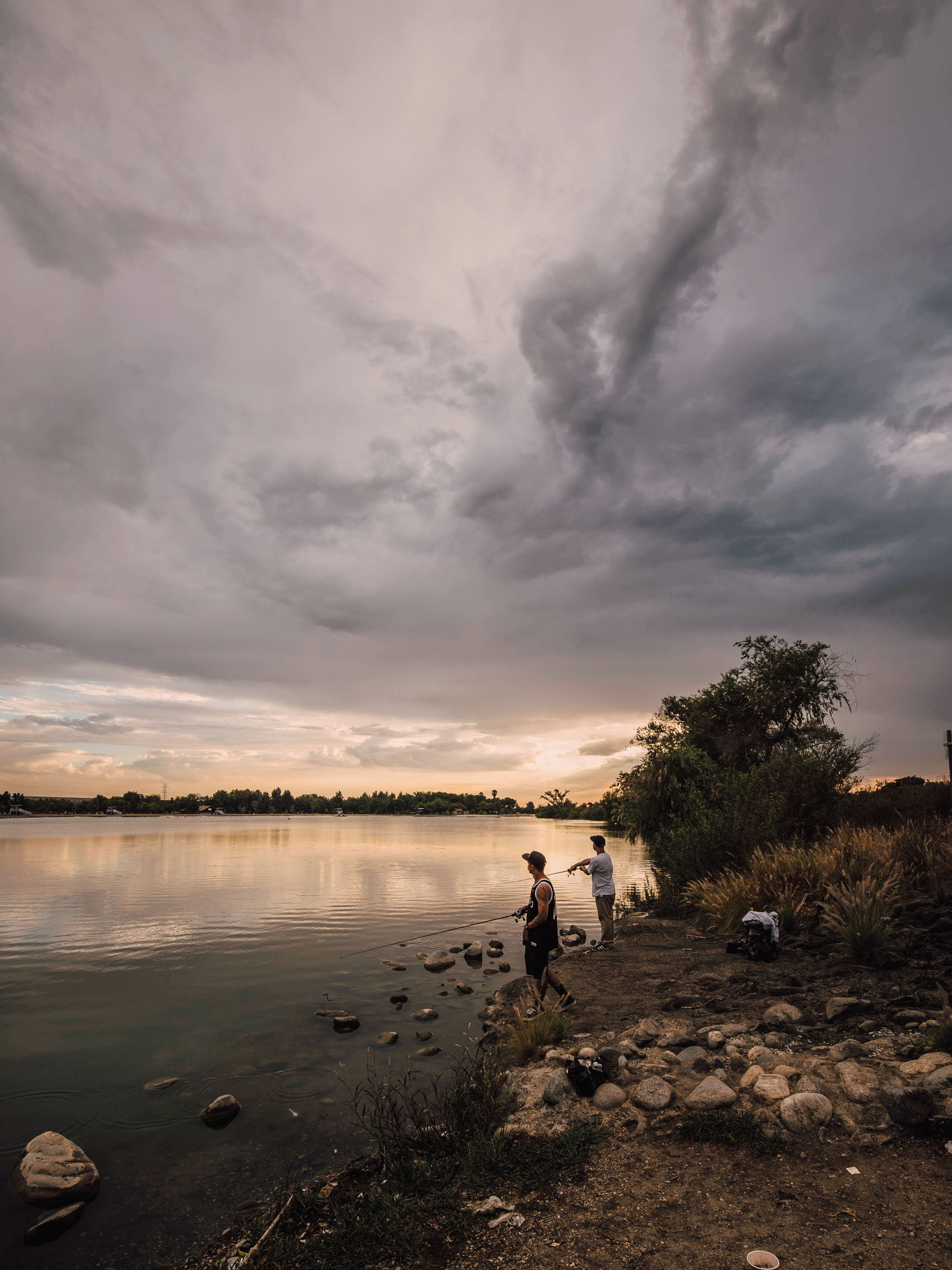 cloud - sky, water, sky, nature, beauty in nature, real people, tranquil scene, tranquility, scenics, sunset, outdoors, full length, tree, one person, standing, lake, men, women, day, people