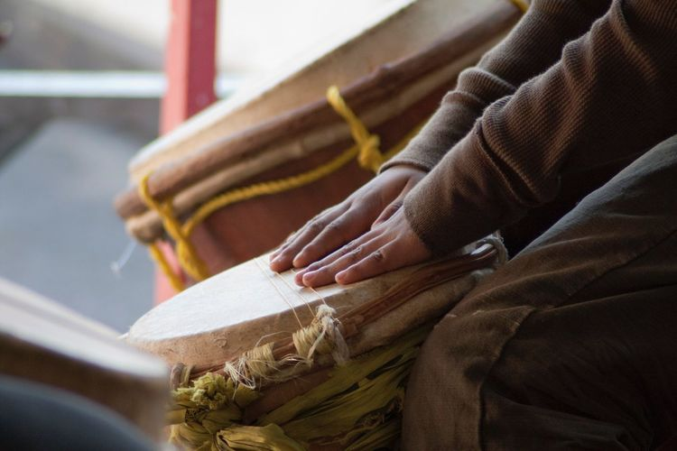Cropped Image Of Man Playing Traditional Drum