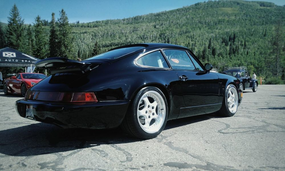 Class Car Transportation No People Day Crash Outdoors Sky Porsche 911 Green Color Grass Vehicle Lights Reflection HighContrastPhotography Low Angle View Sport Wheel Luxury Grainy Photo Automotive Photography Carenthusiastlifestyle Stationary Grainy Images