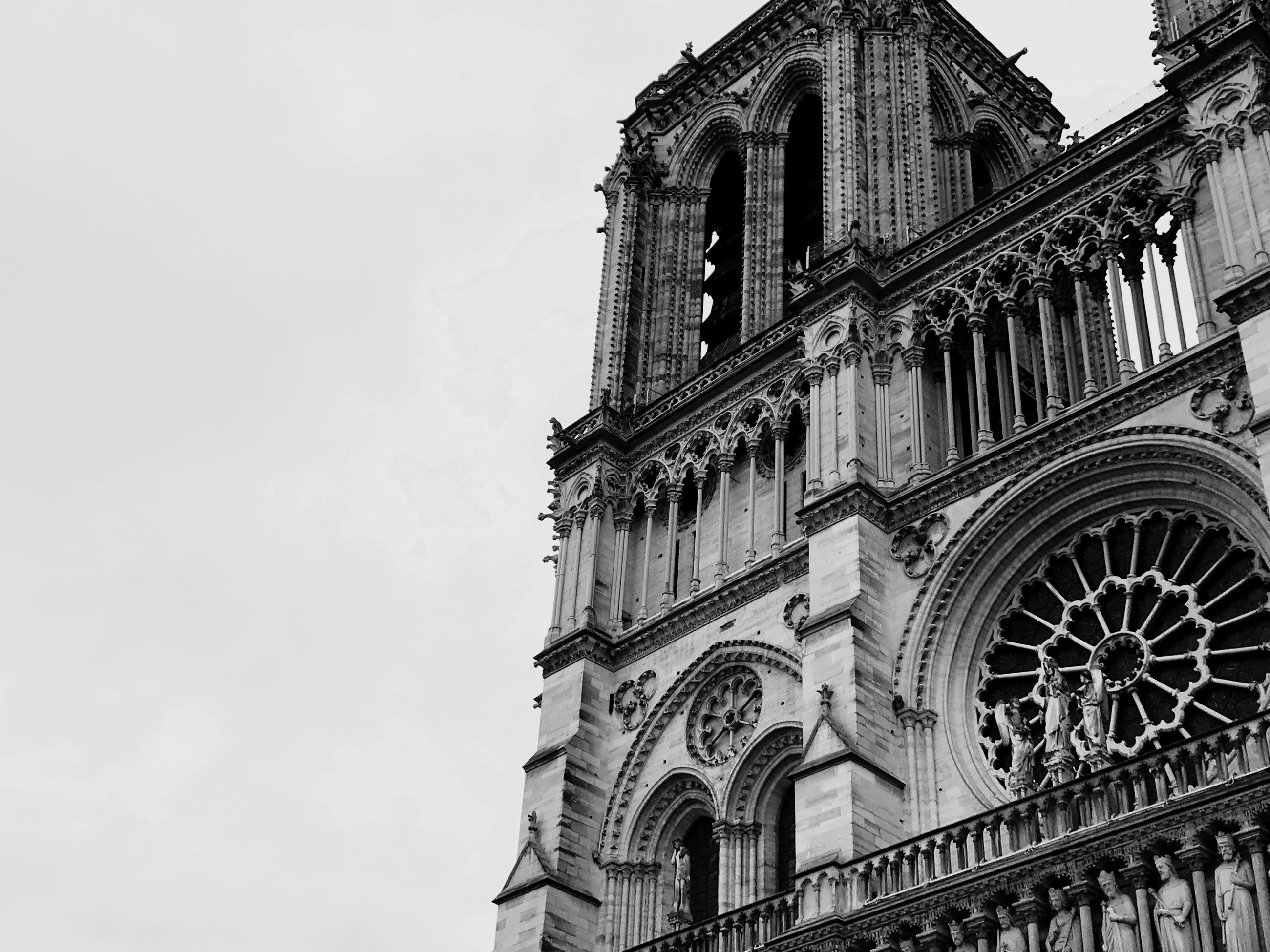 religion, place of worship, low angle view, architecture, spirituality, building exterior, built structure, rose window, outdoors, sky, day, history, no people, travel destinations