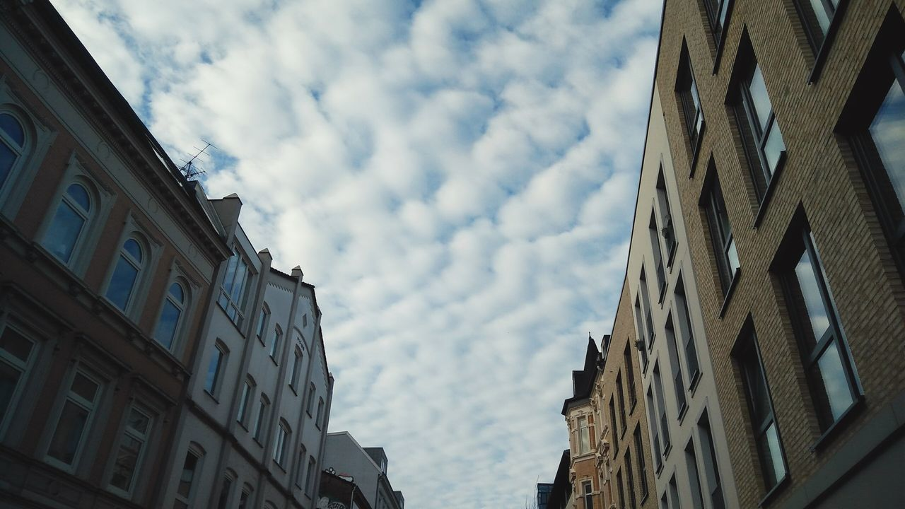 building exterior, low angle view, architecture, built structure, sky, cloud - sky, day, window, no people, outdoors, nature, city