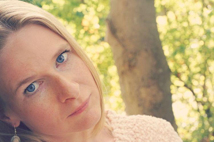 Close-Up Portrait Of Mid Adult Woman At Park