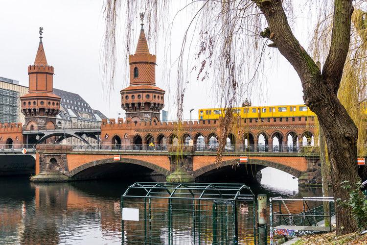 Oberbaum Bridge Over Spree River Against Sky