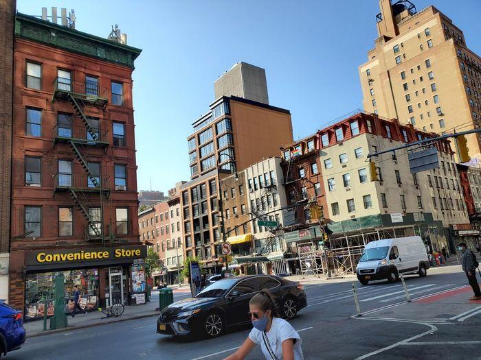 People on city street by buildings