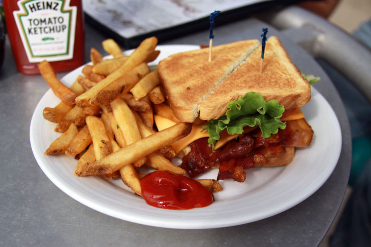 This was taken by me at Seacrets in Ocean City, MD Bacon BLT Bread Delicious First Eyeem Photo Focus On Foreground Food French Fries Heinz Indulgence Ketchup Lettuce Lunch Ocean City Md Ready-to-eat Relaxing Sandwich Seacrets Seacretsusa Toast Tomatorice