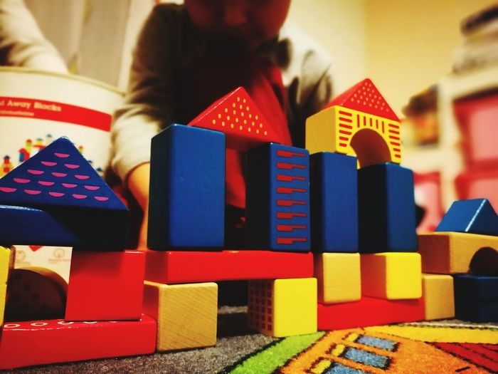plaing with my precious Playing Playing Games Happykid Indoors  Education Multi Colored Business Finance And Industry Toy Block Red Close-up Mobility In Mega Cities Colour Your Horizn Visual Creativity #urbanana: The Urban Playground