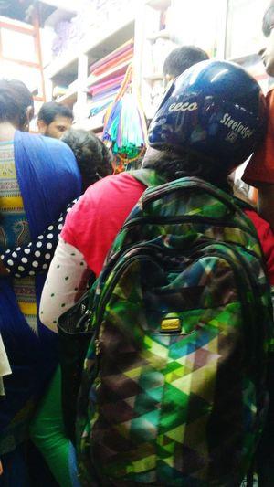 A Customer Wearing Helmet & Attened Shop