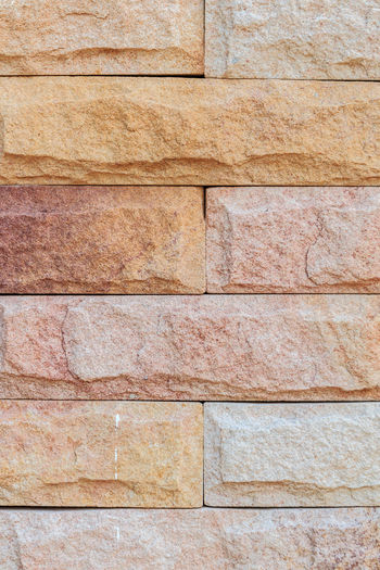 Sandstone wall background Architecture Backgrounds Brown Built Structure Close-up Day Full Frame No People Outdoors Pattern Rough Solid Stone Wall Textured  Wall Wall - Building Feature