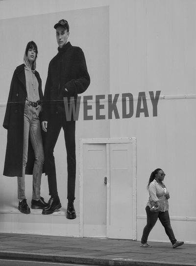 Street Photography Standing People Communication Full Length Two People Adult Day Real People Outdoors Weekday Black And White Monochrome Walking Stepping Out Advertising Poster Doorway Hoarding Words Daytime Cool Eyem Size The Street Photographer - 2017 EyeEm Awards EyeEm LOST IN London