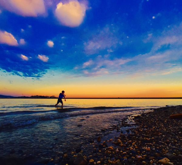 Boy playing on beach The Great Outdoors - 2016 EyeEm Awards The Essence Of Summer
