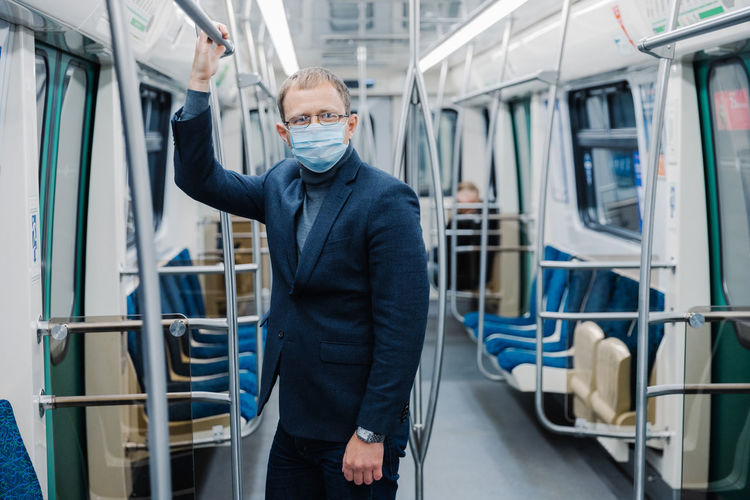 Businessman standing in train