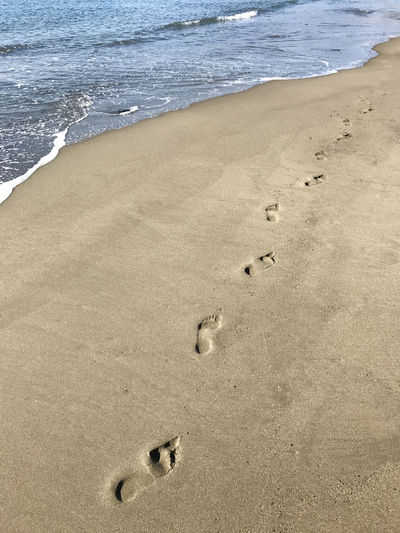 Footprints in sand on beach Beach Beauty In Nature Beauty In Nature Day Foodprint FootPrint Nature No People Outdoors Sand Sea Shore Water Wave