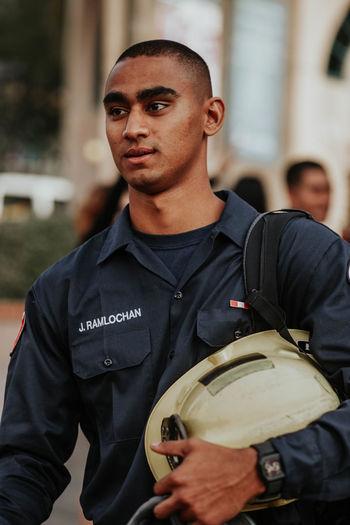 Man In Uniform Standing Outdoors