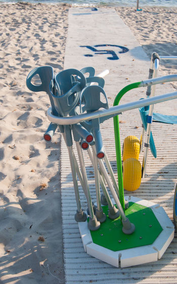 High angle view of crutches at disabled access to beach
