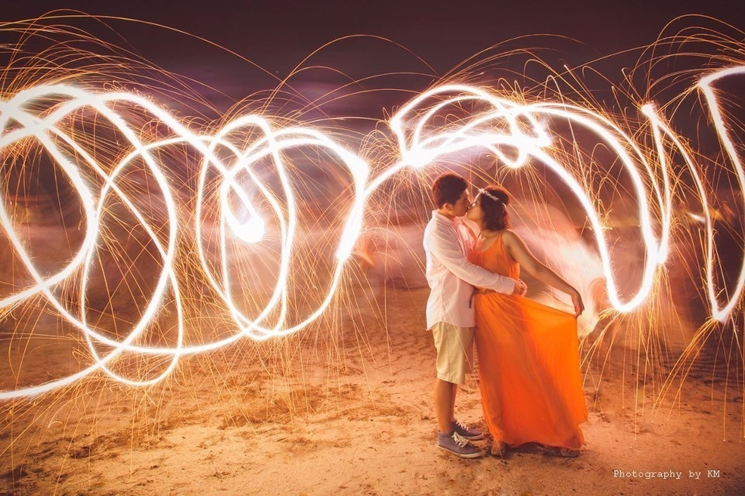 lifestyles, leisure activity, illuminated, night, rear view, full length, casual clothing, standing, person, childhood, motion, girls, men, enjoyment, elementary age, long exposure, outdoors