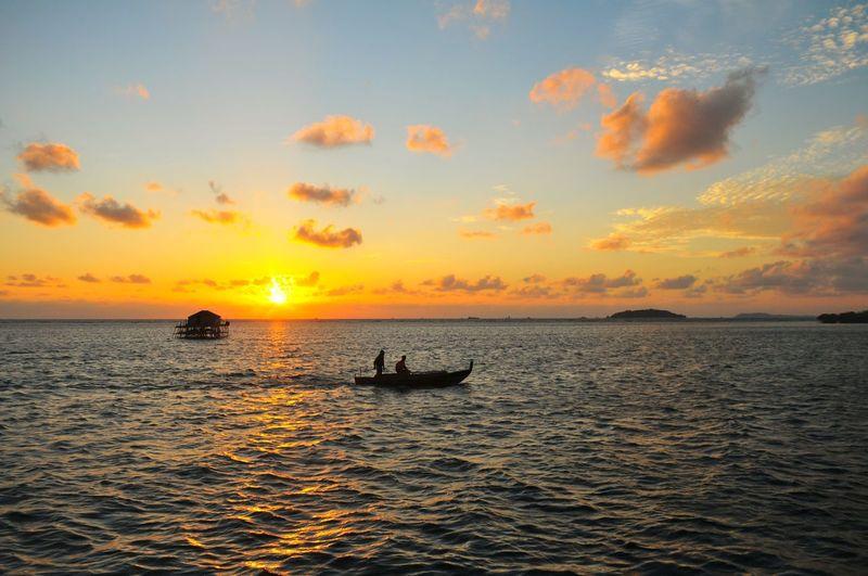 EyeEm Selects EyeEmBestPics Mood Summer Warm Illustration Orange Sunrise Sunrise_sunsets_aroundworld Morning Light Morning Water Nautical Vessel Sea Sunset Beach Wave Sun Silhouette Sea Life Sunlight Seascape Fishing Boat