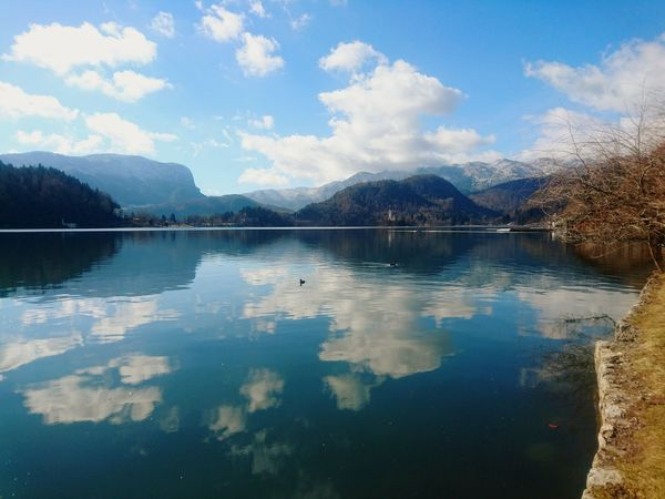 Reflection Cloud - Sky Landscape Blue Tranquility Bled, Slovenia Sky Outdoors Beauty In Nature Mountain Lake Travel Destinations Slovenia Nature Beauty In Nature Life Is A Journey Nofilter Water Day Live For The Story BYOPaper! The Great Outdoors - 2017 EyeEm Awards Lost In The Landscape