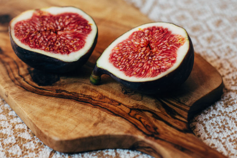 Breakfast Fig Figs Food Food And Drink Freshness Fruit Healthy Eating Healthy Food High Angle View Indoors  Juicy No People Organic Ready-to-eat Red Summer Tropical Fruit Two Is Better Than One Wood Wood - Material Wooden Wooden Texture Close-up