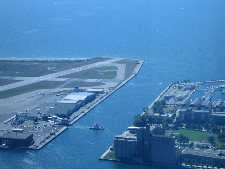 Airport and Harbour. Plane captains have to be careful not to turn into marine captains, crossing the edge. Aerial View Airport Blue Blue Water Boat Cityscape Elevated View Feel The Journey Harbour Mode Of Transport Ontario Ontario Lake Ontario, Canada Original Experiences Toronto Canada Toronto Ontario Travel Destinations Travel Photography Birds Eye View Urban Geometry Urban Landscape Urban Nature View From Above View From CN Tower Cityspaces