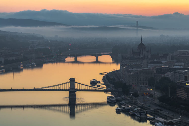 Fog over the city and the river at sunrise