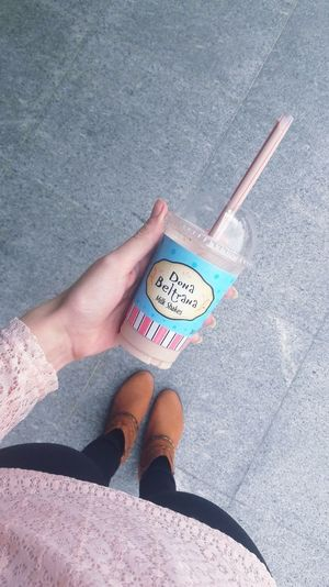Milk-shake lovers! Only Women Human Leg Human Hand Milkshake♥ People One Person Human Body Part High Angle View Personal Perspective Low Section Shadow Adults Only Currency Adult One Woman Only Day Outdoors Close-up