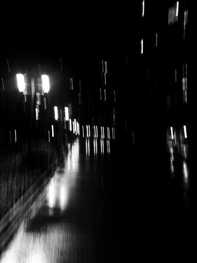 Empty table in illuminated dark room