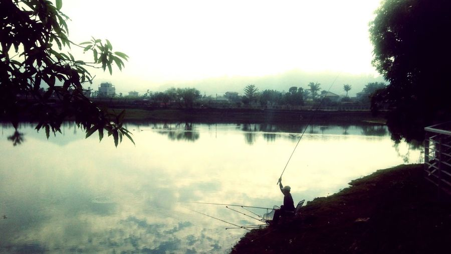 Reflection Water Silhouette Tree Nature Lake Outdoors Sky One Person Beauty In Nature