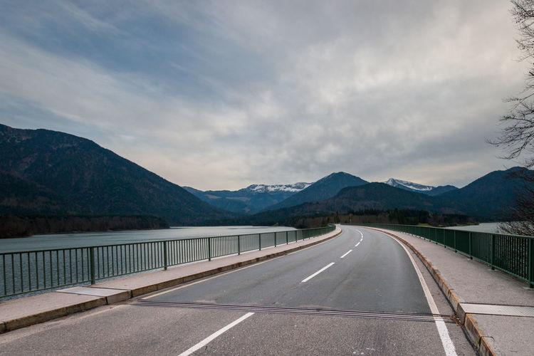 Country road along faller klamm bridge across lake sylvenstein in the alps in bavaria, germany