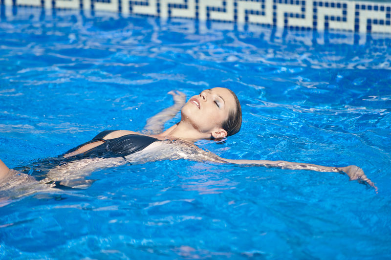 Sensuous woman swimming in pool