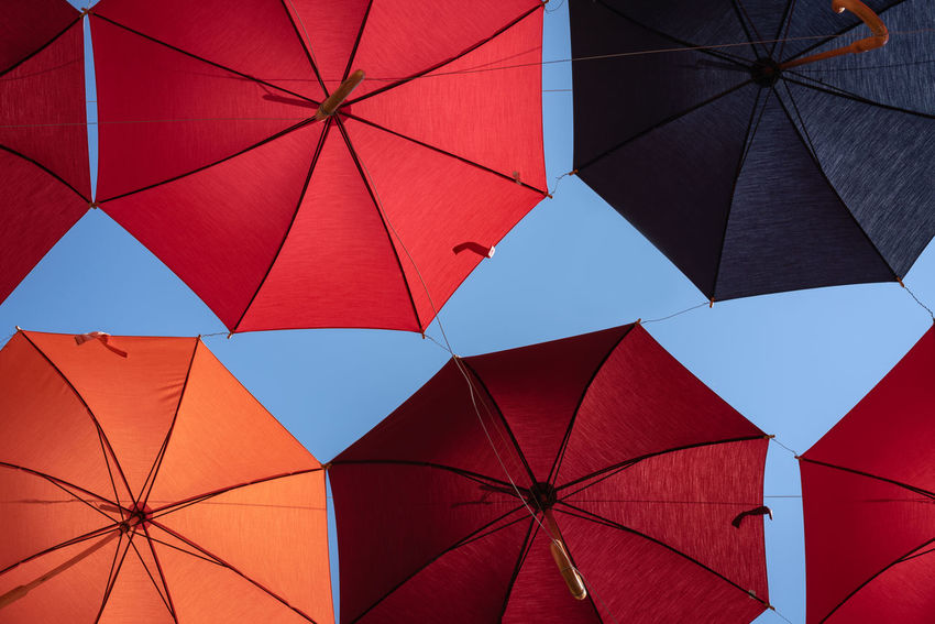 Colors Open Umbrella Backgrounds Blue Sky Colorful Day Full Frame Geometric Shape Hanging Low Angle View Multi Colored Nature No People Outdoors Parasol Pattern Protection Red Safety Security Shape Sky Skyscraper Umbrella Umbrellas My Best Travel Photo