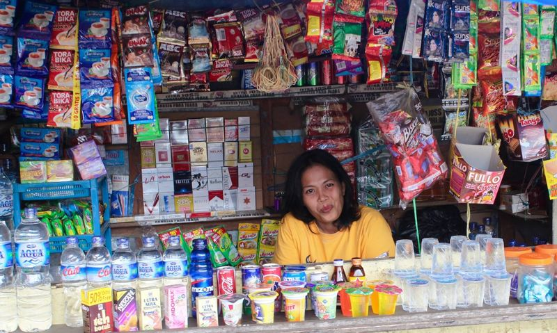 INDONESIA Indonesian Sulawesi Abundance Bottle Choice Day Food Front View Indoors  Large Group Of Objects Looking At Camera Mid Adult Multi Colored One Person People Portrait Real People Retail  Smiling Variation Young Adult Young Women