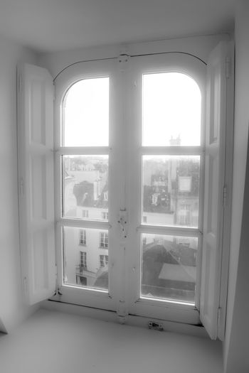 Parisien window Window Transparent Indoors  Glass - Material Architecture Day No People Building Built Structure Nature Entrance House Door Open Sky Sunlight Safety Security Window Frame Arch Light Light And Shadow Blackandwhite City Cityscape Paris France Europe Shutters