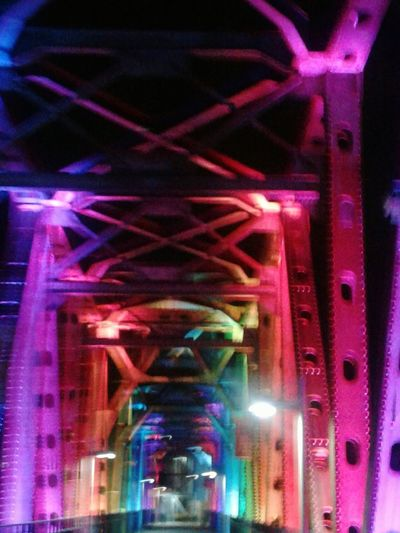 Illuminated Night Built Structure Low Angle View Architecture Multi Colored No People Neon Bridge Photography Multiple Light Sources Metal Industry Architecture Outdoors Bridge - Man Made Structure Motion Effect Motion Blur Effect Night Photography Capture The Moment The Way Forward Vibrant Colors