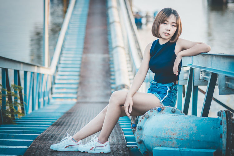 Beautiful Woman Casual Clothing Day Full Length Girls Hairstyle Innocence Leisure Activity Lifestyles One Person Outdoors Portrait Real People Sitting Women