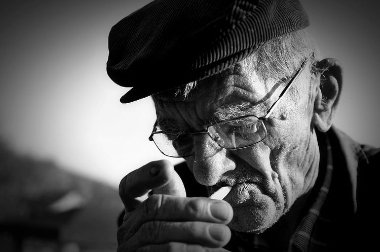 One Man Only Close-up Mature Adult Low Angle View Outdoor Photography Contrast Blackandwhite Smoking People Day Herzegovina Portret Light And Shadow Outdoor Photography Hat Glasses Old Man EyeEmNewHere