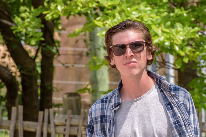 College student walking outside on campus wearing sunglasses The Portraitist - 2017 EyeEm Awards Young Adult One Person Sunglasses Selective Focus Sunny Day Outdoors College Life Student College Campus College Campus Walking Campus Life Young Man Freshman Sophomore  Junior Year Senior Class Day Daylight Sunshine Sunlight The Portraitist - 2017 EyeEm Awards