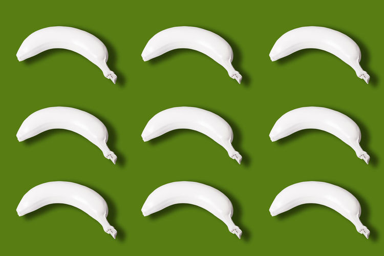 top view of many white colored bananas isolated on green background Bananas Many White Isolated Green Color Background View Top Colored Abstract Fresh Healthy Natural Food Fruit Ripe Delicious Snack Dessert Nutrition Freshness Diet Concept Vitamin Gourmet Organic Plant Tropical Creative Whole Nature Art Nutritious Layout Design Breeding Macro Style Peel Skin Sweet Pattern Bright Lay Vegetarian Tasty Above Raw Idea