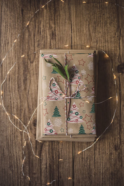 Wrapped gifts on wooden table Christmas Holiday Love Wrap Chritsmas Close-up Day Decoration Directly Above Gift High Angle View Indoors  No People Paper Table Wood - Material Wrapped