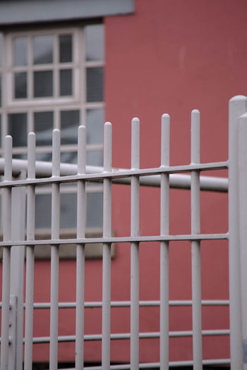 Architecture Barrier Boundary Building Building Exterior Built Structure Close-up Day Fence Focus On Foreground Metal Minimal No People Outdoors Pattern Protection Red Safety Security Wall - Building Feature White Color