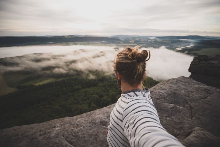 Epic travel selfie Roamers Roam View Real People Outdoors Adventure Selfie Hipster Man Bun Mountain Nature Scenics One Person Rear View Day Leisure Activity Beauty In Nature Real People Sky Landscape Mountain Range Standing Tranquility Outdoors Tranquil Scene Casual Clothing Vacations Travel Destinations