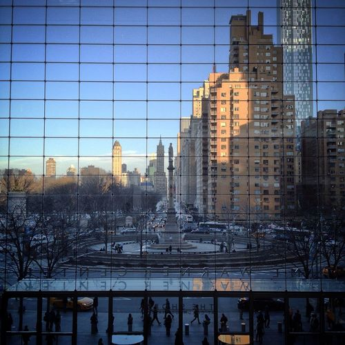 Columbus monument seen from 150-foot glass curtain of time warner center